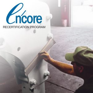 Worker applying tape to FRD Drill with Encore logo in upper left corner of image.